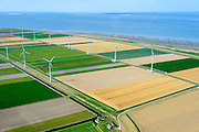 Nederland, Groningen, Gemeente Eemsmond, 05-08-2014;  Emmapolder met windturbines, windmolenpark. In de voorgrond de klassike windmolen De Goliath, een watermolen (poldermolen).<br /> Emmapolder, North Netherland, wind farm. Windmill in the foreground.<br /> luchtfoto (toeslag op standard tarieven);<br /> aerial photo (additional fee required);<br /> copyright foto/photo Siebe Swart