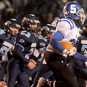 Scotland's Robert McKoy rushes against Hoggard Friday November 28, 2014 at Hoggard High School in Wilmington, N.C. (Jason A. Frizzelle)