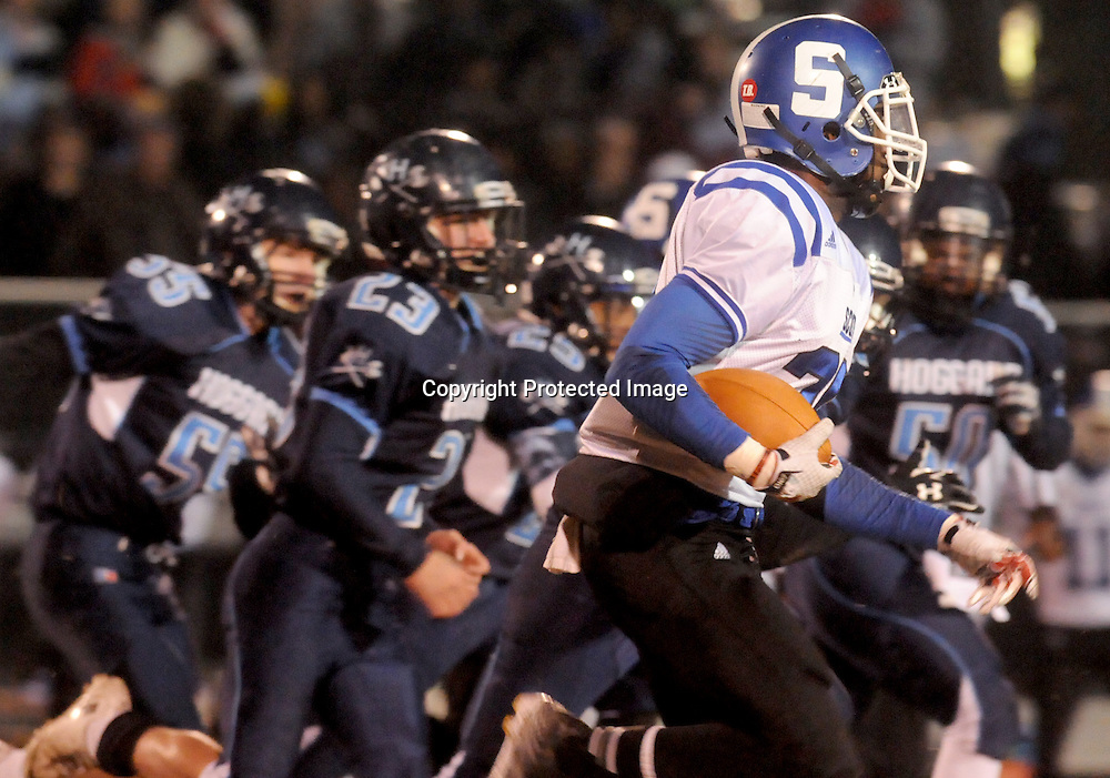 Scotland's Robert McKoy rushes against Hoggard Friday November 28, 2014 at Hoggard High School in Wilmington, N.C. (Jason A. Frizzelle)
