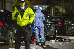 © Licensed to London News Pictures. 16/02/2020. London, UK. A forensic investigator gathers evidence next to medical equipment on the ground at the scene of a multiple stabbing in Barking. Photo credit: Peter Manning/LNP
