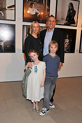 Photographer JOANNA VESTEY, her husband STEVEN BROOKS and their children CHLOE & JAGO at a private view of photographs by Joanna Vestey entitled 'Dreams For My Daughter' in aid of The White Ribbon Alliance, held at The Royal Festival Hall, South Bank, London on 8th March 2012.