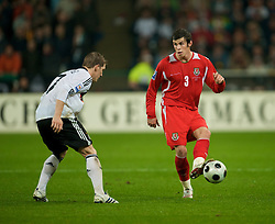 MONCHENGLADBACH, GERMANY - Wednesday, October 15, 2008: Wales' Gareth Bale and Germany's Bastian Schweinsteiger during the 2010 FIFA World Cup South Africa Qualifying Group 4 match at the Borussia-Park Stadium. (Photo by David Rawcliffe/Propaganda)