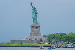 July 4, 2018 - New York, New York, United States - Liberty Island was evacuated because of a person climbing the Statue of Liberty's base on the Fourth of July shortly after seven protesters who unfurled an ''Abolish ICE'' banner from the statue's pedestal calling for abolishing Immigration and Customs Enforcement were arrested. (Credit Image: © Erik Mcgregor/Pacific Press via ZUMA Wire)