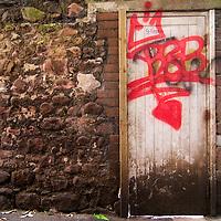 Derelict door with graffiti