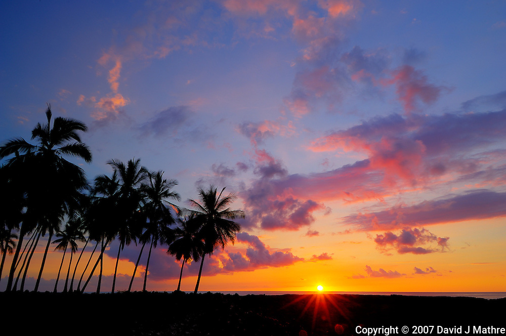 Sunset at  Pu'uhonua o Honaunau National Historic Park, Big Island Hawaii. Image taken with a Nikon D2xs and 12-24 mm f/4 lens (ISO 100, 16 mm, f/22, 1/2.5 sec).