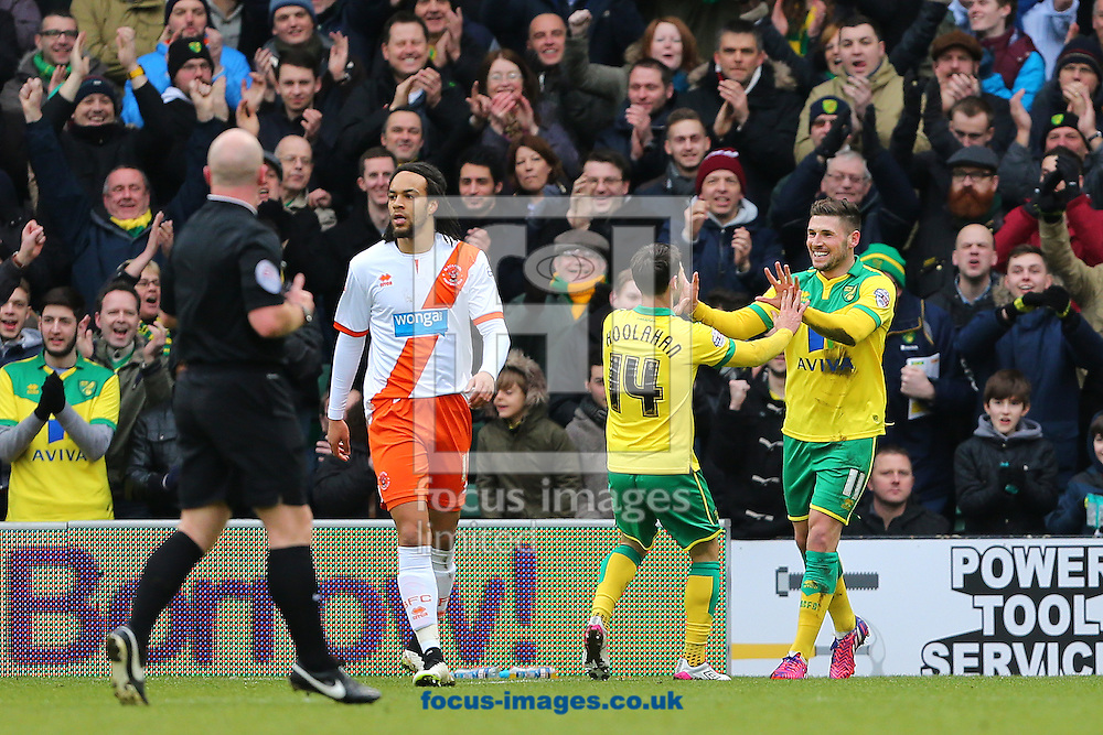 Gary Hooper of Norwich City (right) celebrates with team mate, Wesley Hoolahan after scoring the opening goal of the Sky Bet Championship match at Carrow Road, Norwich<br /> Picture by Richard Calver/Focus Images Ltd +447792 981244<br /> 07/02/2015