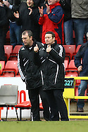 Swindon - Saturday March 20th, 2010: Swindon Manager Danny Wilson gives the thumbs up as he sees   his side equalize with the last kick of the game during the Coca Cola League One match at The County Ground, Swindon. (Pic by Paul Chesterton/Focus Images)