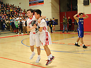 Watertown High School senior Isaac Huff (left) and senior Lance Kuo celebrate after winning the MIAA Division 3 North Sectional Final, beating Bedford High School 59-52, at Burlington High School, March 11, 2017.   [Wicked Local Photo/James Jesson]