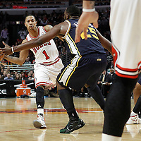 10 March 2012: Chicago Bulls point guard Derrick Rose (1) passes the ball during the Chicago Bulls 111-97 victory over the Utah Jazz at the United Center, Chicago, Illinois, USA.