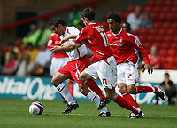 Photo: Rich Eaton. <br /> <br /> Nottingham Forest v AFC Bournemouth. Coca Cola Championship. 11/08/2007. Bournemouth's Paul Telfer (l) attacks chased by Scott Dobie.