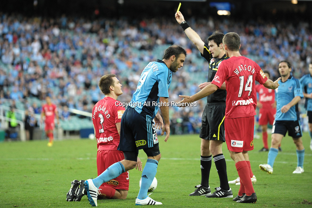 22.12.2011 Sydney, Australia.Adelaide defender Nigel Boogaard gets a yellow card for giving away a penalty during the A-League game between Sydney FC and Adelaide United played at the Sydney Football Stadium.