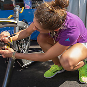 August 19, 2014, New Haven, CT:<br /> Andrea Petkovic autographs a spin bike after riding on it to raise money for Yale New Haven Health on day five of the 2014 Connecticut Open at the Yale University Tennis Center in New Haven, Connecticut Tuesday, August 19, 2014.<br /> (Photo by Billie Weiss/Connecticut Open)