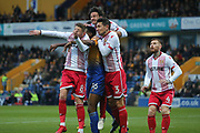 Hayden White of Mansfield Town (16) Harry Beautyman of Stevenage (8) and Joe Martin of Stevenage (1) jump for the ball during the EFL Sky Bet League 2 match between Mansfield Town and Stevenage at the One Call Stadium, Mansfield, England on 18 November 2017. Photo by Mick Haynes.