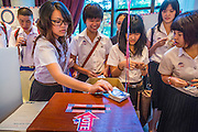 07 NOVEMBER 2012 - BANGKOK, THAILAND:  Thai high school students participate in a mock election set up by the US Embassy at the Embassy's election watch party in Bangkok. US President Barack Obama won a second term Tuesday when he defeated Republican Mitt Romney. Preliminary tallies gave the President more than 300 electoral votes, well over the 270 needed to win. The election in the United States was closely watched in Thailand, which historically has very close ties with the United States. The American Embassy in Bangkok sponsored an election watching event which drew thousands to a downtown Bangkok hotel. American Democrats in Bangkok had their own election watch party at a restaurant in Bangkok.      PHOTO BY JACK KURTZ