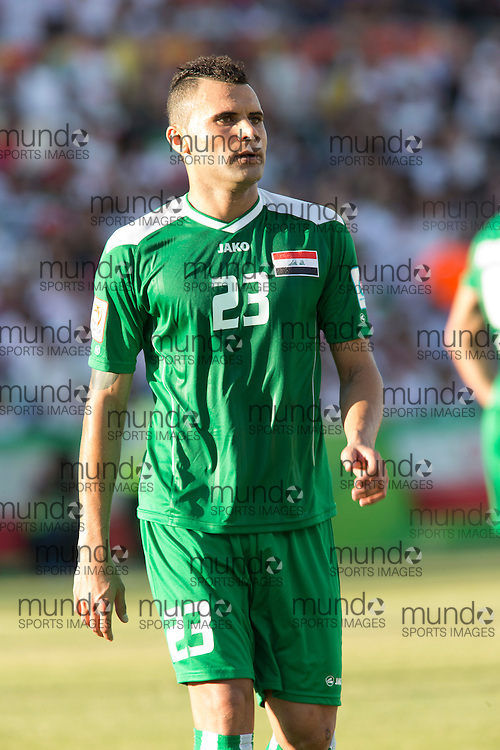 (Canberra, Australia---23 January 2015) Waleed Salim (23) of Iraq playing against Iran in the FIFA Asian Football Confederation 2015 Asian Cup quarter-final game played in Canberra Stadium, Canberra, Australia.