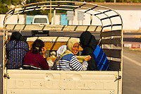 Women riding in the back of a truck in Tatouine, Tunisia