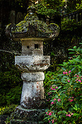 One of the many stone lanterns in the gardens in Nikko