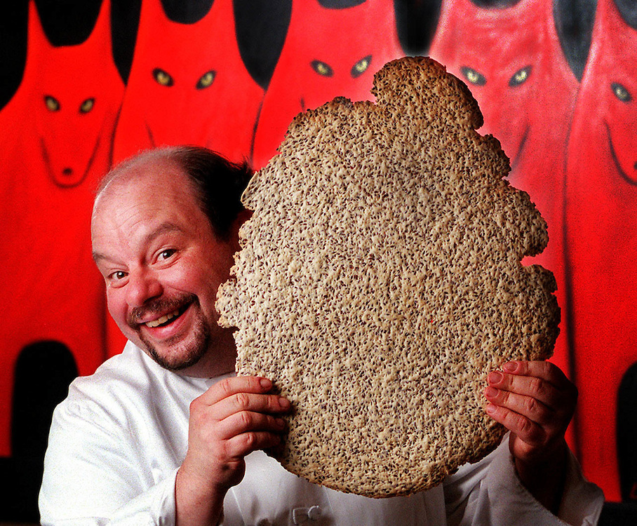 Nava pastry chef Kirk Parks poses with one of his flaxseed crackers.