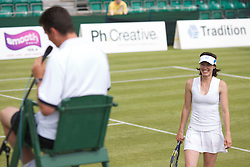 MANCHESTER, ENGLAND: Martina Hingis (SUI) is all smiles as Richard Krajicek assumes the role of Umpire during Day one of the Manchester Masters Tennis Tournament at the Northern Tennis Club. (Pic by David Tickle/Propaganda)