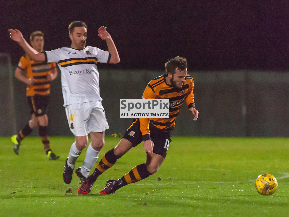 #17 Jon Routledge (Dumbarton) fells #18 Steven Hetherington (Alloa Athletic)