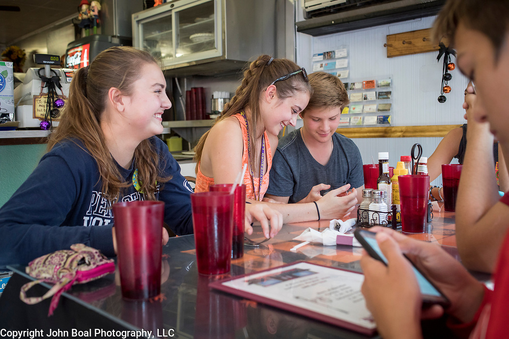 From left, Haley Mapes, 17, Hannah Yoder, 17, Adam Smith, 15 and Chase Mapes, 16 sit at a table with fellow members of the Smithsburg High School Marching Band inside the Dixie Diner, in downtown Smithsburg, Maryland, on Tuesday, September 26, 2017. Smithsburg is a very different town than the southern part of the district that includes Potomac and Germantown. Originally a District that was mostly rural, but included towns like Frederick and Hagerstown, Maryland's 6th District was redistricted in 2011, combining rural northern Maryland regions with more affluent communities like near Washington D.C. turning the district from Republican to Democrat. <br />  <br /> CREDIT: John Boal for The Wall Street Journal<br /> GERRYMANDER