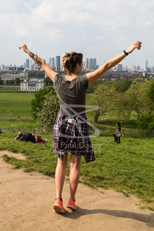A woman enjoys the view over Docklands in London, seen from Maze Hill, Greenwich as Mayor Sadiq Khan announces air toxicity alerts for the Capital. London, May 08 2018.