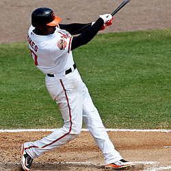 March 24, 2012; Sarasota, FL, USA; Baltimore Orioles center fielder Adam Jones (10) hits a two run single during the bottom of the fourth inning of a spring training game against the Washington Nationals at Ed Smith Stadium.  Mandatory Credit: Derick E. Hingle-US PRESSWIRE