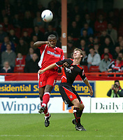 Photo: Kevin Poolman.<br />Swindon Town v Lincoln City. Coca Cola League 2. 28/10/2006. Aaron Brown of Swindon (L) and Ryan Amoo of Lincoln both go for a header.