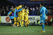 Sutton players celebrating winning the game during the The FA Cup third round replay match between AFC Wimbledon and Sutton United at the Cherry Red Records Stadium, Kingston, England on 17 January 2017. Photo by Matthew Redman.