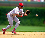 CHICAGO:  Barry Larkin of the Cincinnati Reds fields during an MLB game against the Chicago Cubs at Wrigley Field in Chicago, Illinois.  Larkin played for the Reds from 1986-2004.   (Photo by Ron Vesely)   Subject: Barry Larkin.