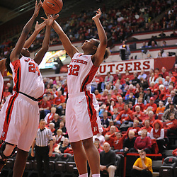 Jan 31, 2009; Piscataway, NJ, USA; Rutgers forward Brooklyn Pope (32) and forward Myia McCurdy (24) reach for an offensive rebound during the second half of South Florida's 59-56 victory over Rutgers in NCAA women's college basketball at the Louis Brown Athletic Center