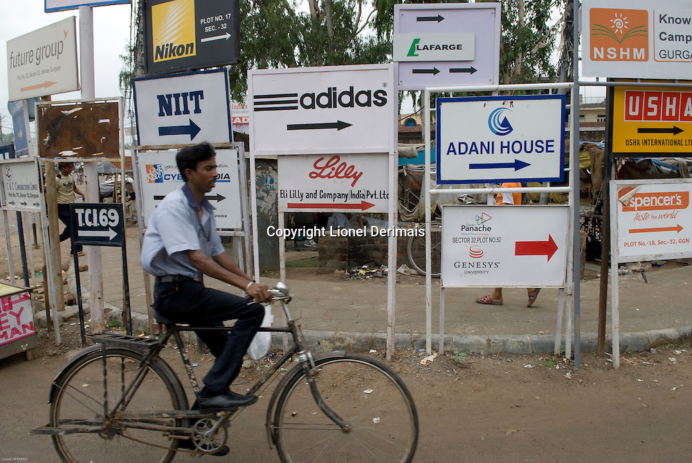 Signs indicating foreign companies in Gurgaon, New Delhi's new CBD, an hour South of the city. India.