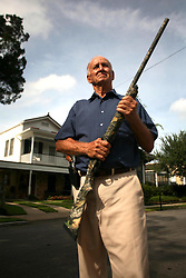 31 August 2008. New Orleans, Louisiana. USA..Hurricane Gustav preparations. Armed and staying. Ray Hoffman has fresh ammunition and clean guns ready to protect his property if need be. Uptown residents refusing to leave and ready to deal with any potential threat from looters. .Photo; Charlie Varley.