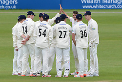 David Payne of Gloucestershire celebrates with Liam Norwell of Gloucestershire as Billings is caught by Gareth Roderick of Gloucestershire after Payne's bowl  - Photo mandatory by-line: Dougie Allward/JMP - Mobile: 07966 386802 - 19/05/2015 - SPORT - Cricket - Bristol - County Ground - Gloucestershire v Kent - LV=County Cricket Division 2