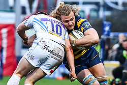 David Denton of Worcester Warriors is tackled by Joe Simmonds of Exeter Chiefs - Mandatory by-line: Craig Thomas/JMP - 27/01/2018 - RUGBY - Sixways Stadium - Worcester, England - Worcester Warriors v Exeter Chiefs - Anglo Welsh Cup