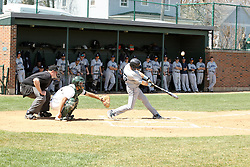 14 April 2013:  Chris Fisher bats in front of A.J. Nathan and umpire Steve Jones during an NCAA division 3 College Conference of Illinois and Wisconsin (CCIW) Baseball game between the Elmhurst Bluejays and the Illinois Wesleyan Titans in Jack Horenberger Stadium, Bloomington IL