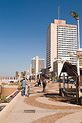 Israel, Tel Aviv, Sheraton Tel Aviv Hotel on the beach front. The promenade in the foreground