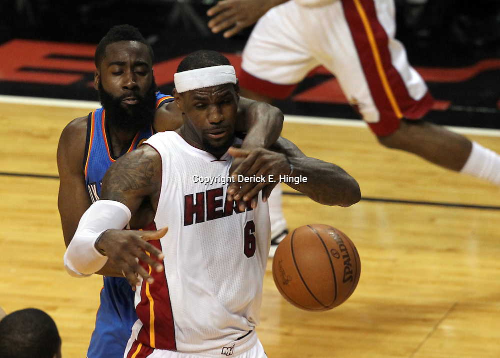 Jun 19, 2012; Miami, FL, USA; Miami Heat small forward LeBron James (6) and Oklahoma City Thunder guard James Harden (13) go for a rebound during the second quarter in game four in the 2012 NBA Finals at the American Airlines Arena. Mandatory Credit: Derick E. Hingle-US PRESSWIRE