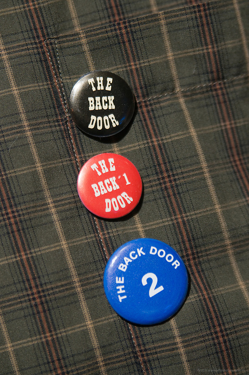 David Benson wears pins from the first three anniversary years during the 25th anniversary party for the The Back Door and The Back Burner Grill, Thursday, Jan. 14, 2010 in Louisville, Ky. (Photo by Brian Bohannon)