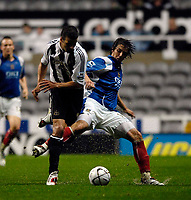 Photo: Jed Wee.<br /> Newcastle United v Portsmouth. Carling Cup. 25/10/2006.<br /> <br /> Portsmouth's Niko Kranjcar (R) tries to hold off Newcastle's Steven Taylor.