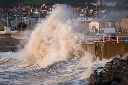 © Licensed to London News Pictures. 21/09/2018. Aberystwyth, UK. The gale force winds of Storm Bronagh, the second named storm of the UK winter, still bring waves battering against the seafront at Aberystwyth during the evening high tide after a day of winds, heavy rain and thunderstorms. Photo credit: Keith Morris/LNP