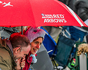 A Red Arrows and a Unicorn hat provide protection from the rain - The Duxford Battle of Britain Air Show is a finale to the centenary of the Royal Air Force (RAF) with a celebration of 100 years of RAF history and a vision of its innovative future capability.