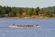 A Millenium Dragon Boat from The GO Rowing & Paddling Association of Canada in Nanaimo Harbour, Nanaimo, British Columbia, Canada.  Newcastle Island Marine Provincial Park can be seen in the background.