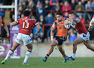 Mikey Sio (L) and Tinirau Arona (R) of Wakefield Trinity Wildcats try to stop Jesse Sene-Lefao of Castleford Tigers during the Pre-season Friendly match at Belle Vue, Wakefield<br /> Picture by Richard Land/Focus Images Ltd +44 7713 507003<br /> 15/01/2017