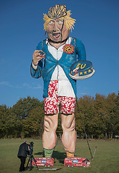 © Licensed to London News Pictures. 31/10/2018. Edenbridge, UK. An effigy of former foreign secretary Boris Johnson is unveiled in Edenbridge, Kent ahead of its burning at the town's bonfire this Saturday. The 10 meter high figure stands over two EU referendum buses and Boris is also carrying an EU cake. Photo credit: Peter Macdiarmid/LNP