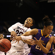 Tanaya Atkinson, (left), Temple, challenges for a rebound with Abria Trice, East Carolina, during the Temple Vs East Carolina Quarterfinal Basketball game during the American Women's College Basketball Championships 2015 at Mohegan Sun Arena, Uncasville, Connecticut, USA. 7th March 2015. Photo Tim Clayton