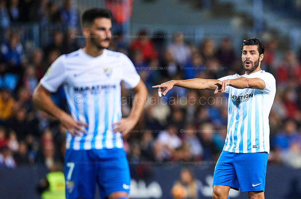MALAGA, SPAIN - DECEMBER 09:  Miguel Torres of Malaga CF reacts during La Liga match between Malaga CF and Granada CF at La Rosaleda Stadium December 9, 2016 in Malaga, Spain.  (Photo by Aitor Alcalde Colomer/Getty Images)