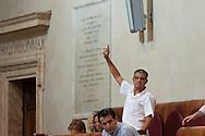 Roma, 9  Luglio 2012.Consiglio comunale in Campidoglio nell'aula Giulio Cesare per  la discussione sulla  cessione del 21% della controllata Acea, l'azienda che si occupa di acqua e servizi. Andrea Alzetta, La Sinistra l'Arcobaleno