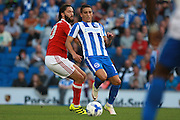 Nottingham Forest midfielder Henri Lansbury (10)  & Brighton & Hove Albion winger Anthony Knockaert during the EFL Sky Bet Championship match between Brighton and Hove Albion and Nottingham Forest at the American Express Community Stadium, Brighton and Hove, England on 12 August 2016. Photo by Bennett Dean.