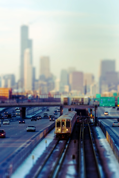 Approaching the 35th St station, a southbound Dan Ryan Red Line L train motors down the middle of the expressway under the famous Chicago skyline.